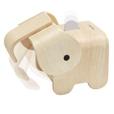 The beautifully-designed Elephant Bank attractively serves as a piece of decor in any room! The adorable bank helps motivate children to save money and learn math skills while also enhancing their fine motor skills. Put a coin into the slot and raise the elephant's head up to let the coin drop. PlanToys mainly focuses on safe wooden toys made of reclaimed rubber woods that enhance development for children, especially during their first five formative years when parents should encourage… Playroom Shelves, Eco Brand, Plan Toys, Elephant Head, Play Centre, Natural Wood Finish, Buy Buy Baby, Kids Store, Pottery Barn Kids