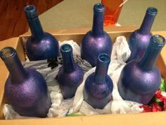 Paint wine bottles with glitter spray paint from micheals for a more decorative look :)