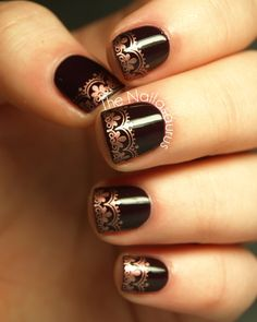 From Nailasaurus - I used Rimmel Deliciously Dark as my case colour and then stamped on a lace design from Konad Plate M57 using Beauty UK Olympic Bronze. It's topped off with a coat of Seche Vite.
