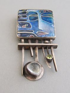River Spirit brooch. one inch by one inch cloisonné enamel on fine silver, set in sterling. handmade steel pin mechanism. Overall dimensions for the pin are one inch by two inches. Accent stones: aquamarine, faceted tube-set peridot - Anna Carlton Metals, Santa Fe New Mexico