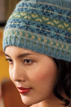 "This gorgeous hat, by Yoko Hatta for the ""F is for Fair Isle"" section of the Holiday issue of Vogue features traditional Fair Isle motifs and six cool tones of Road to China Light: Aquamarine, Jade, Citrine, Blue Tourmaline, Malachite and Lapis. The use of the subtle shades of color really makes the Lapis (the darkest blu"