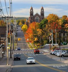Autumn in Downtown Marquette, Michigan. *Sigh* our colors are late this year, so alas! it does not look like this yet. Marquette Michigan, Michigan Travel, State Of Michigan, Northern Michigan, Great Places, Beautiful Places, Places To Visit, Great Lakes Region, Upper Peninsula