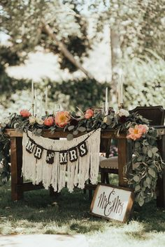 For the Mr. and Mrs. that want something to include dessert table, this wedding decor inspiration is perfect for you! The creative sign paired with the floral table runner will bring your bohemian theme all together.  #bohowedding #weddingtheme #bohodecorations #weddingideas