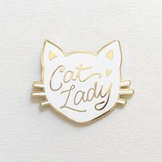 "It's your favorite Cat Lady Pin, also in White! Details - 1.5"" x 1.25"" size - Cloisonné hard enamel set in 22kt plated gold - Rubber clutch clasp - Illustrated & © by Brianna Bulski"