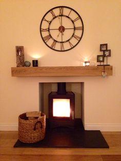 Oak mantle, log burner, cosy fire