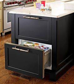 Housing a set of refrigerator drawers in an island extends the amount of cold storage without carving out space for a second full-size fridge. Install the unit at island's end to make it possible for both kids and adults to help themselves without getting in the way of the cook.