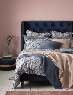 We love this bedroom style. A beautiful statement navy bed with our new beautiful Roses bed linen topped with soft knitted throws in blue and pink. We love to mix blush pink and blue and could spend a lot of Sunday mornings snoozing here. Blue And Pink Bedroom, Navy Blue Bedrooms, Blush Pink Bedroom, Navy Bedroom Walls, Blush Bedroom Decor, Blue Carpet Bedroom, Pink Room, Bedroom Color Schemes, Bedroom Colors