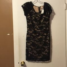 Black lace dress new✨  SALE✨ Black lace dress with zip up back. Size large. Tag still on dress. one clothing Dresses Mini