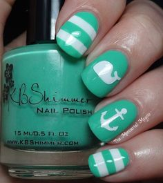 Summer Nail Art Wave 3: Nautical Nails. Stripes and anchors look good on nails. Check out this wonderful teal and white nautical design from The Mercurial Magpie.