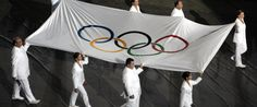 The Olympic flag is carried during closing ceremony of Athens 2004 Olympic Games.