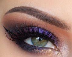 Purple smokey eye makeup with gold glitter