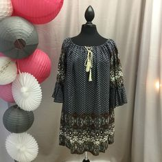 How cute is this bell sleeve dress?? Accented with crisscross rope tie and tassel at the neck. 65% cotton 35% polyester