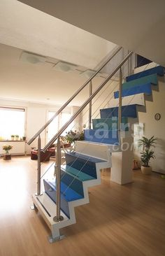 An EeStairs straight staircase, using steel and coloured a variety of vibrant shades