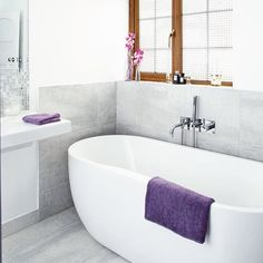 Hmm don't mind this!  This large family bathroom has been given an air of luxury with an impressive freestanding bath and streamlined tiling.