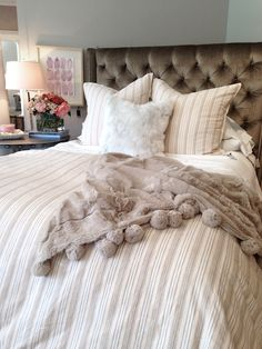 alice lane home collection | upholstered velvet headboard, fur pillow, fur throw, striped bedding, striped duvet, gem art, nightstands styling