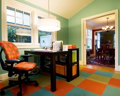Just steps from the kitchen is a new office that is home to the owner's graphic design company.  The new Marvin windows match the style of the original home.