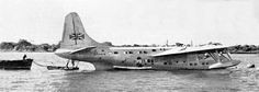 """A Short Solent (a civil transport developed from the RAF Short S.25 Sunderland) flying boat on the waters of the Zambezi River in what is now Zimbabwe. This BOAC stopover on the Springbok Route between Southampton Water and Cape Town was located close to Livingstone, just upstream of the Victoria Falls. To crews and passengers alike, it became known fondly as """"Jungle Junction"""", and the magnificent Victoria Falls Hotel were used to accommodate all on the layover."""