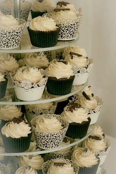 Cup cake wedding cake - Love this idea with maybe a layer cake on top for the couple to cut/save for their 1st anniversary.
