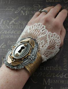 @Linda Murdoch - SECRET DOOR II, Victorian steampunk antique lock key hole cuff bracelet with ivory lace. $62.00, via Etsy.