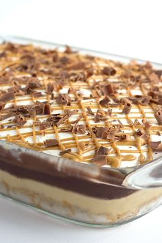 Chocolate Peanut Butter Layer Dessert - buttery pretzel crust, peanut butter cheesecake mousse, chocolate pudding, hot fudge, whipped cream and a peanut butter drizzle!