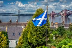 The Saltire, the Forth Road Bridge (left) and the Forth Rail Bridge (right), South Queensferry, Scotland.