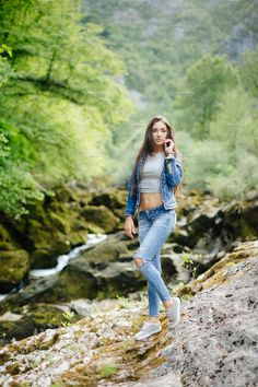 Long hair woman posing in mountains. female model in jeans. Girl Photo Poses, Picture Poses, Girl Poses, Fashion Photography Poses, Fashion Poses, Portrait Photography, Poses For Photos, Photos Du, New Foto