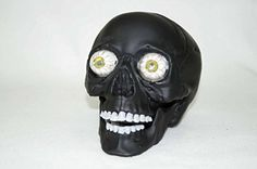 Add a creepy touch to your Halloween decor with our black skull with light-up LED eyes!