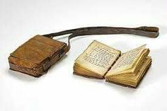 Ethiopia:-  Spritual Books & Leather Strap Cases. ( Ethiopian traditional way of keeping ancient religious books. )