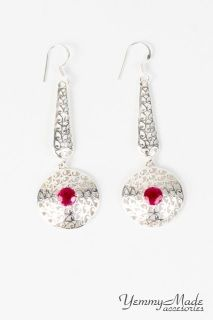 An elegant pair of Onyx faceted filigree drop earrings in sterling silver. This pair is in  faceted Onyx Red rounds that dangle in a pair of filigree drop rounds with sterling silver ear wires. Sets Available:  1 set