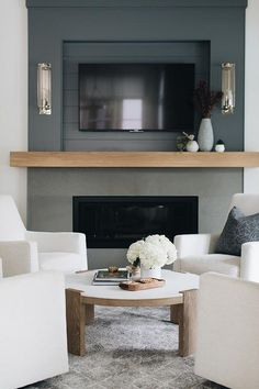 Dec 2019 - Transitional living room + living room with fireplace + wooden mantle + tv above fireplace + built-in tv niche + sitting room + accent chairs + white swivel chairs + round coffee table Tv Above Fireplace, Linear Fireplace, White Fireplace, Modern Fireplace, Fireplace Mantle, Fireplace Surrounds, Fireplace Design, Shiplap Fireplace, Fireplaces With Tv Above