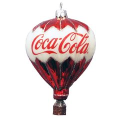 Kurt Adler Coca-Cola Glass Balloon Ornament, Bring a touch of nostalgic charm to your holiday décor with this glass Coca-Cola balloon ornament by Kurt Adler. Its hot air balloon design features a red and white color scheme and the classic Coca-Cola logo. Coca Cola Santa, Coca Cola Christmas, Coca Cola Ad, Always Coca Cola, Pepsi, Air Balloon, Balloons, Glass Ornaments, Christmas Ornaments