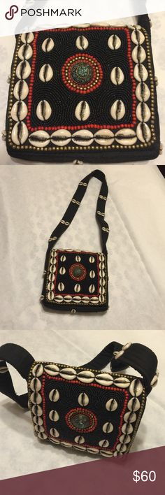 "Handcrafted bead/she'll  bag. A black cotton color bag with a beautiful cowry shells, beads and stone work. 7""x7"". Shoulder strap also has cowry and is 1.5"" wide. Bags Crossbody Bags"
