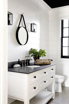 Modern farmhouse bathroom with ship lap walls, white vanity, black counter and natural fiber accents. Rustic Bathroom Vanities, Modern Farmhouse Bathroom, Rustic Farmhouse, Shiplap Bathroom, Farmhouse Small, Mirror Bathroom, Design Bathroom, Bathroom Cabinets, Bathroom Furniture