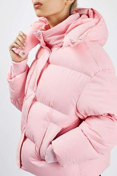Look cute while keeping warm in this super puffy jacket in baby pink, featuring a hood, enamel poppers, elasticated cuffs and heavily wadded zip through detail. Wear with a cosy jumper and ripped jeans for a cool and casual look. #Topshop