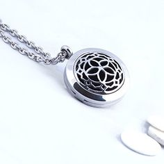 Aromatherapy Essential Oil Diffuser Necklace Jewelry ~ Elegant - Hypo-Allergenic 316L Surgical Grade Stainless Steel Locket Pendant Necklace For Aromatherapy On The Go! INCLUDES 3 WASHABLE Pads! Fine Line Living http://www.amazon.com/dp/B00YBFSA1Q/ref=cm_sw_r_pi_dp_Thukwb0EM9FTR