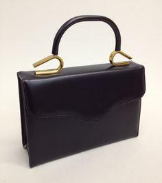 1950s Handbag Black with Gold Handle, Vintage Purse. $20.00, via Etsy.