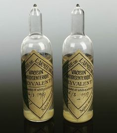 """Two glass ampoules for dysentery vaccine, c.1917. This vaccine was used to vaccinate soldiers against dysentery during World War I. The disease affects the small intestine, causing diarrhoea and vomiting, and is spread through contaminated food and water. The name of the Laboratoire de l'Armée, which made this vaccine, translates as the """"Army Laboratory."""""""