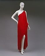 Evening dress. he one-shouldered gown appeared in many of Halston's collections. He was especially interested in the bias-spiraling of fabric over the body. Although this gown is modest in its coverage of the body, its sliced neckline and tentative anchoring on the right shoulder convey a potential for nudity and allude to the classical Greek fashion of fixing the himation, or cloak, at the shoulder to drape in a fall at one side.