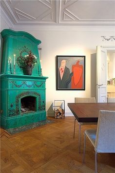 This is a gorgeous fireplace that got a makeover with a great green paint. This absolutely makes it antique modern. Wish I had a fireplace in my room!