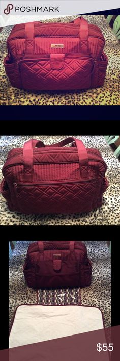 "Make a Change Baby diaper bag in burgundy Like-new condition.  I ended up only using this a couple months before realizing I personally really didn't need it.  Never spilled anything in or on it...it is in perfect shape.  Pockets galore, detachable changing pad, and long handles that clear the ""elbow-to-shoulder"" distance. Vera Bradley Accessories Bags"