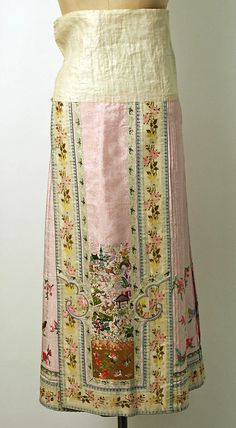 """19th century Chinese Women's """"five-terrace sleeve"""" robe and pleated skirt// Medium: silk, metal // Dimensions: (a) Length: 40 1/4 in. (102.2 cm) (b) Length: 39 in. (99.1 cm) // Credit Line: Gift of Mr. Beaumont Newhall, 1943 // Accession Number: C.I.43.12.84a–c"""