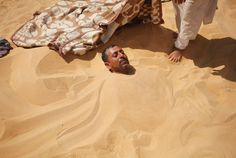The hot sand of the desert probably seems the last place someone wants to be, especially in the searing heat of high summer. But for some, being buried neck-deep in the sand of the Siwa oasis near Dakrour Mountain in western Egypt is their last hope for a cure.