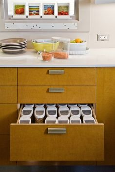 This drawer is deep, which makes it perfect for these tall airtight storage containers.