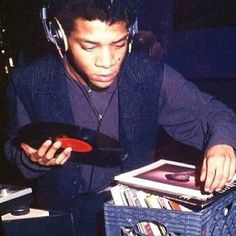 "Legend, artist, icon…DJ, Basquiat on the 1's and 2's. Look out for our upcoming anthology on the band Gray which featured Basquiat as one of the founding members."" (Ubiquity Records)"