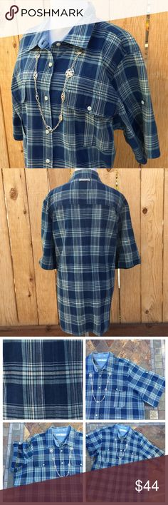"""Tommy Hilfiger Blue Plaid Shirt ⛄️ Button up blue & white short sleeve collar shirt is 100% Cotton. Short sleeves can be rolled up and buttoned as shown in fourth photo. Two front pockets with flap & buttons. Measurements are 27.25"""" pit to pit & 30"""" from shoulder to bottom of shirt. In excellent condition with NO spots or holes. Price cut was $44. Tommy Hilfiger Tops Button Down Shirts"""