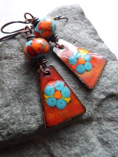 Gorgeous enameled copper charms, expertly handcrafted by Cathleen Zaring, are perfectly matched with beautiful lampwork beads, handcrafted by Susan