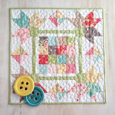 """This 20"""" x 20"""" mini quilt (pattern by Carried Away Quilting) features the new """"Strawberry Fields Revisited"""" line by Fig Tree & Company for Moda.  Charm pack friendly."""
