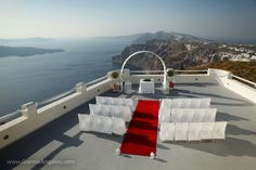 Giannis Angelou.  www.GiannisAngelou.com  Wedding arrangement for ceremony and guests.  Santorini, Greece.