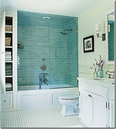 Arched ceiling in tub alcove lets the wall tile flow seamlessly into the ceiling tile.