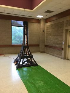 "This freestanding Eiffel Tower is 4ft square at the base, stands 10ft 7in, and has 64ft of Christmas Lights. It is made of 1/8"" hardboard, 2x2's, and 1x8 for the top"
